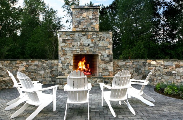 are the benefits to installing an outdoor fireplace in your backyard