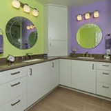 Hall bathroom designed with two vanities and mirrors for two kids.