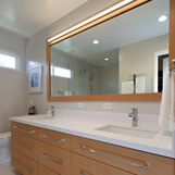 Contemporary Master Bath Remodel featuring custom cabinetry in European Steamed Beech with a natural finish and white quartz countertop.
