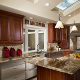 Rustic contemporary Saratoga kitchen remodel with cherry wood cabinets and stainless steel appliances.