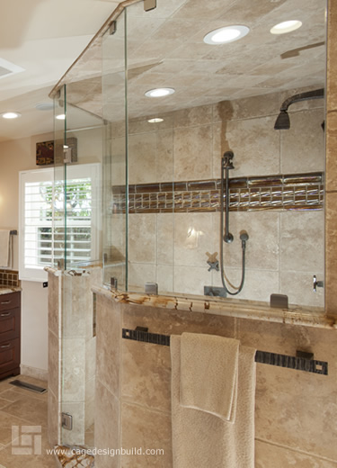 Master bathroom remodel featuring an oversized shower with frameless shower doors and dual shower heads.