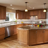 Kitchen remodel included DeWils Cabinetry with an alder wood using a brown glazed finish, granite countertops, Milgard windows and oak hardwood floors.
