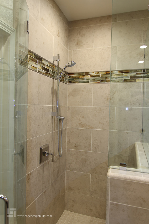 Master Bath Featuring Porcelain Tile Quartz Countertops Frameless Shower Surround And Lunada Bay