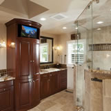 Master bathroom remodel featured an oversized shower with frameless shower doors and dual shower heads.