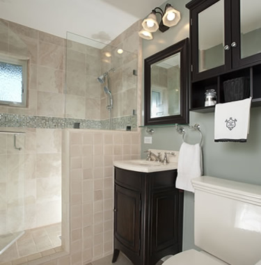 Remodeled hall bathroom features beautiful soft green paint, a radius sink vanity and an oversized