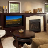 Remodeled family room features a redesigned fireplace and built-in TV enclosure.