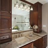 Master bath remodel features a Jacuzzi tub and a long counter with vanity area. His and her magnified vanity mirror is included.